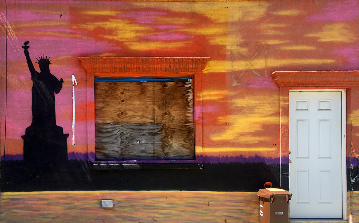 front of house with sunset painting