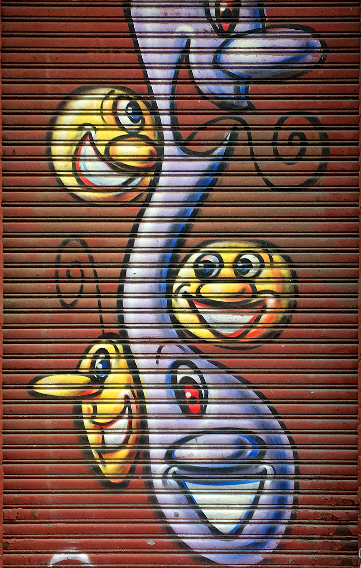 grafitti spray paint cartoon faces smiling