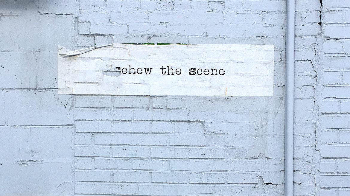 "paste up graphic with the phrase, ""eschew the scene"" written"