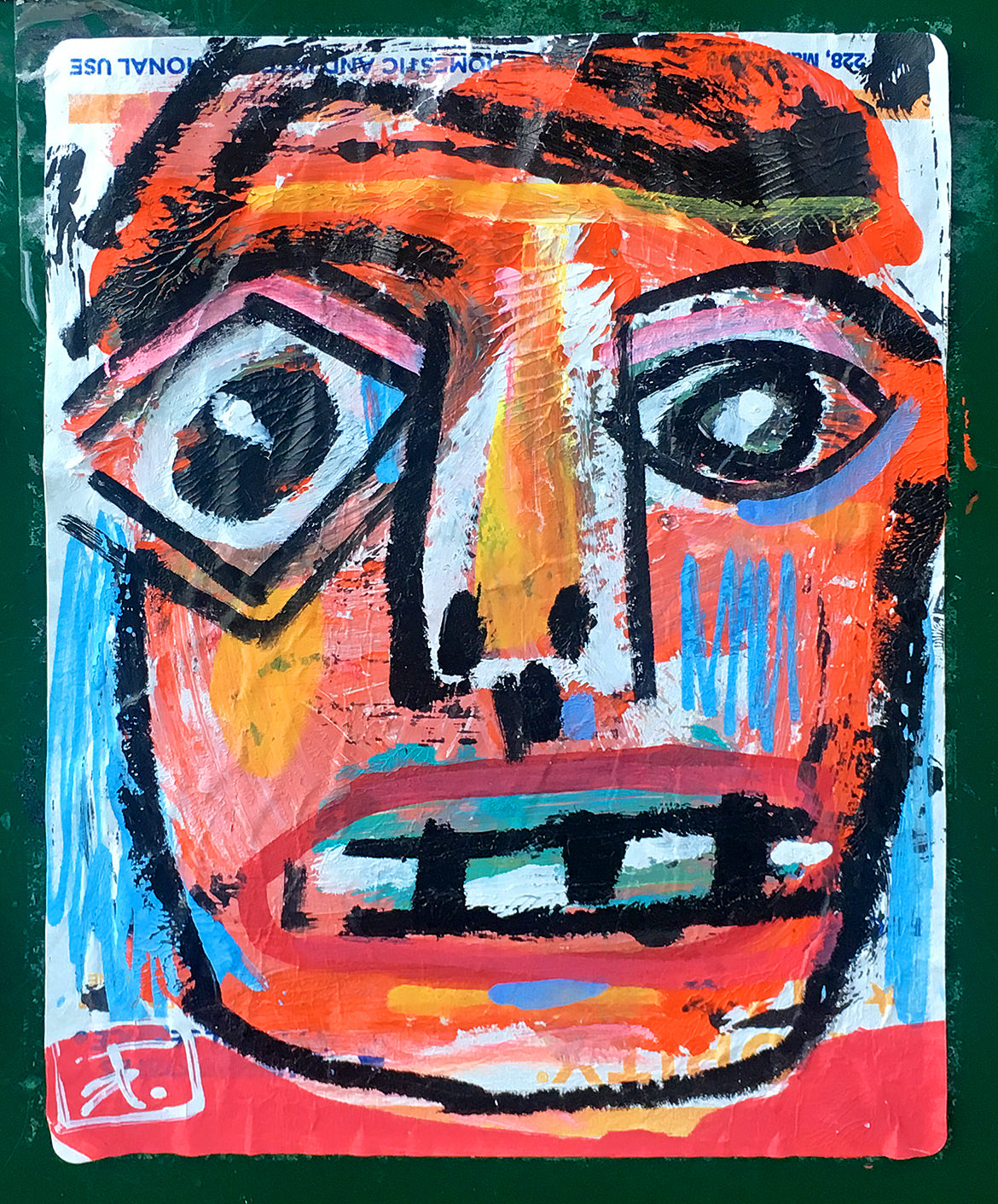 colorful painted face on a postal address label sticker
