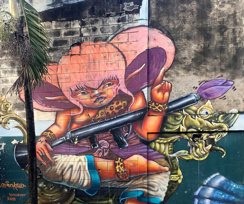 graffiti mural of a cartoon girl holding a rocket launcher