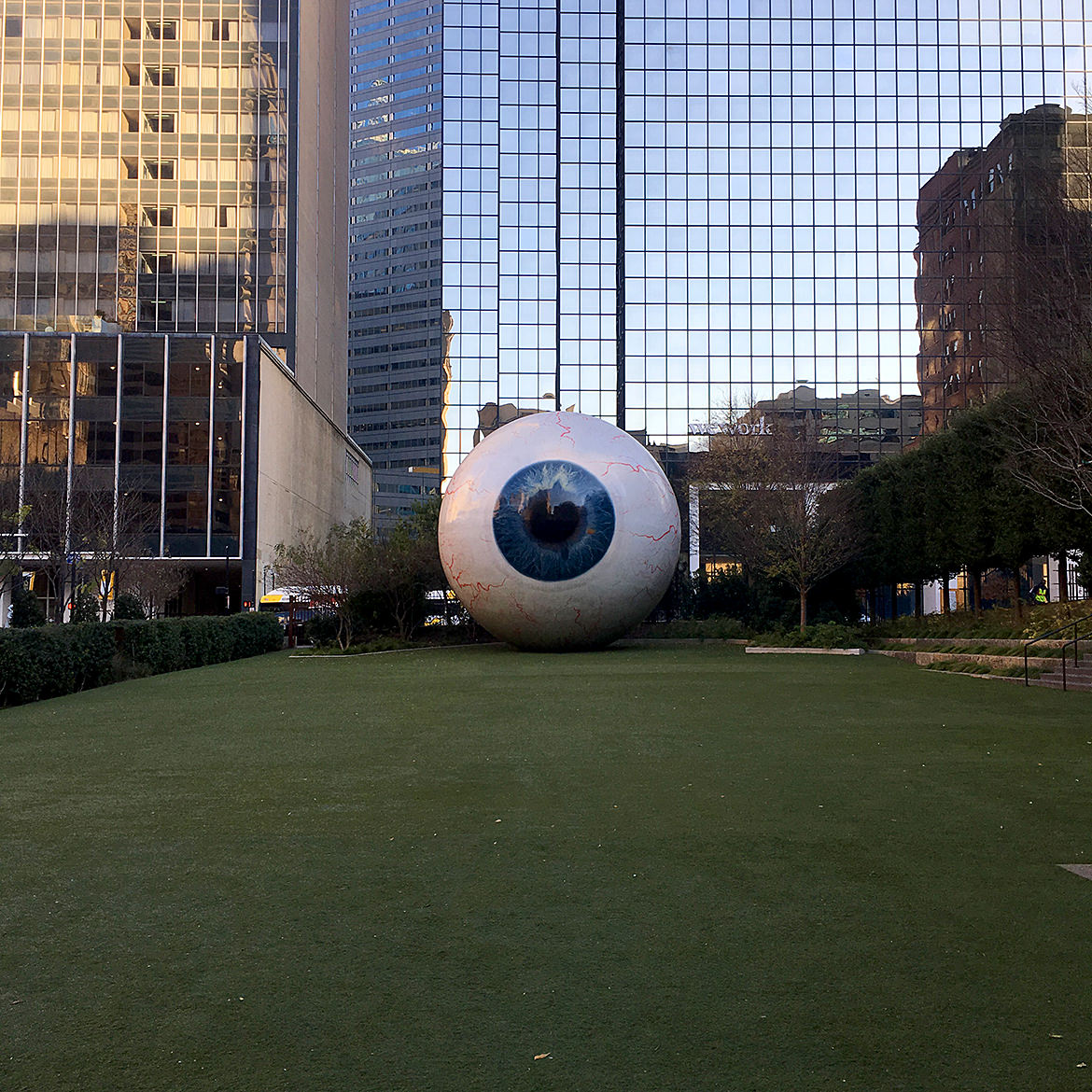 a giant fiberglass sculpture of a human eye, long view