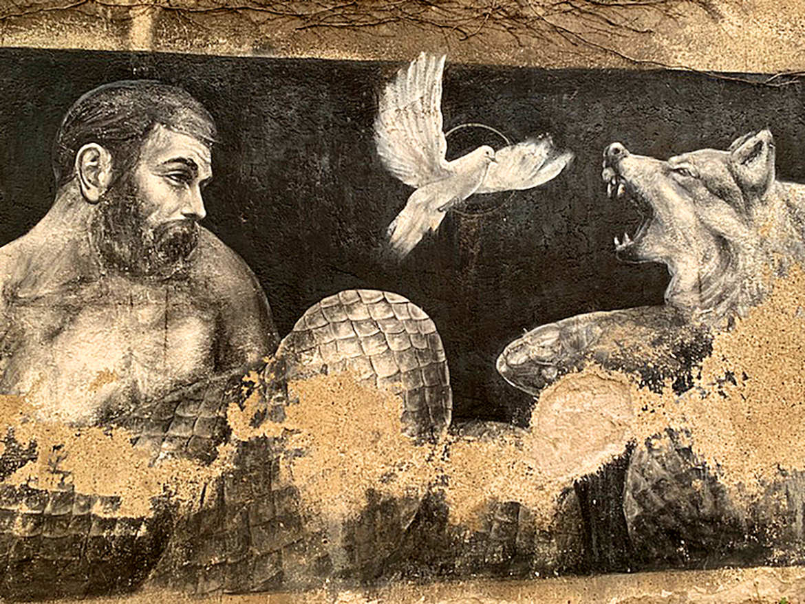 Street mural of a dove flying up between a man and a snarling wolf