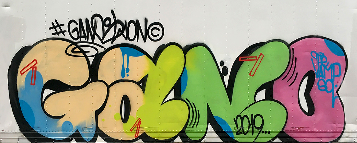 Spray paint graffiti of a fat letters with dark shadowing