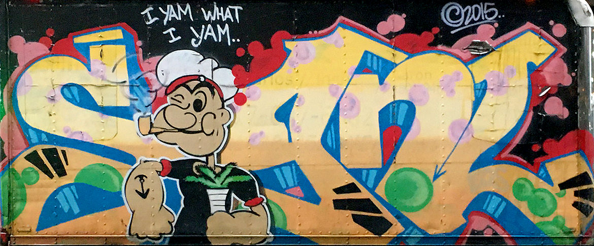 Spray paint graffiti of lettering with the cartoon character Popeye