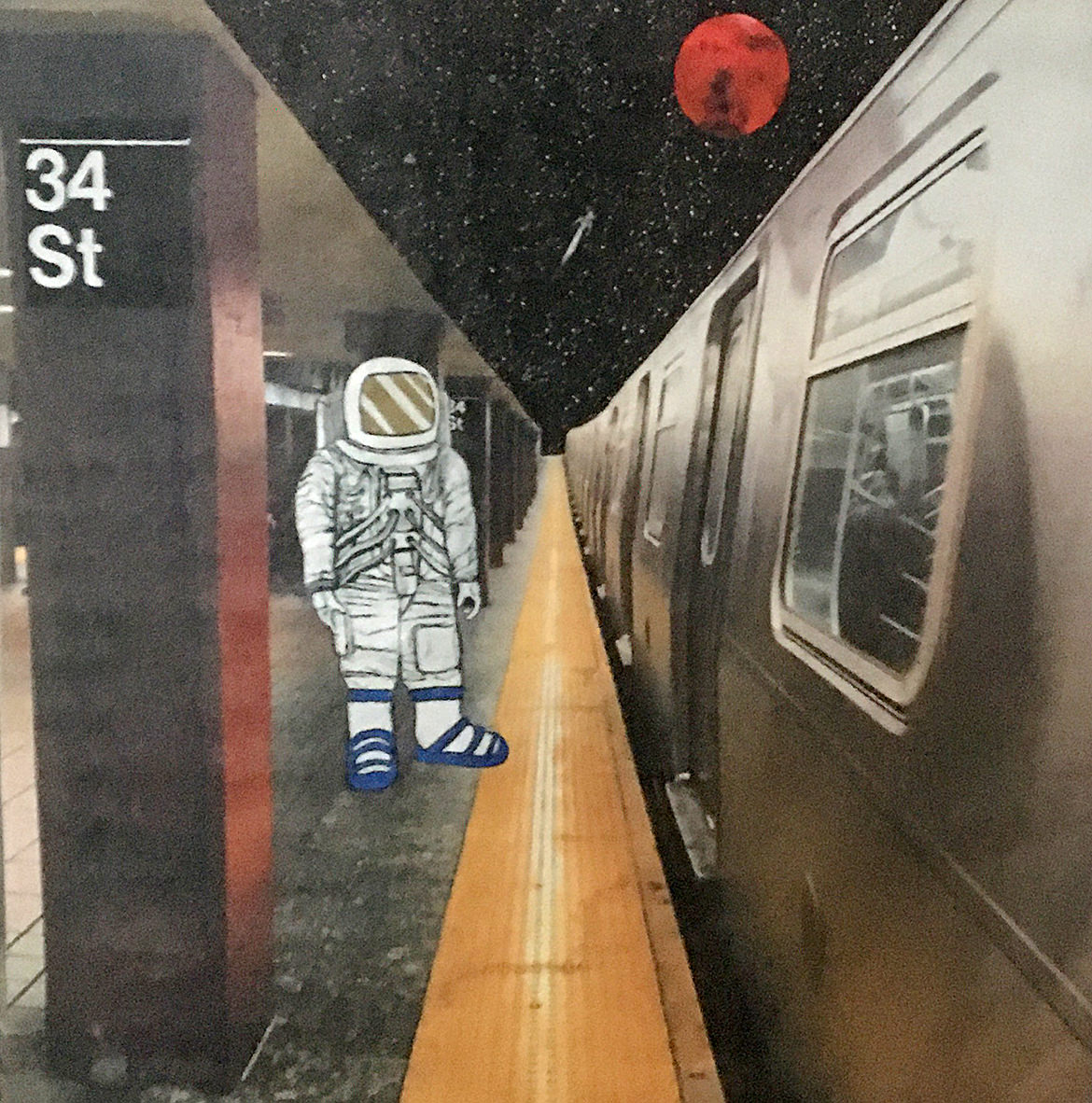 A sticker illustration of an astronaut stands on the 34th Street subway platform