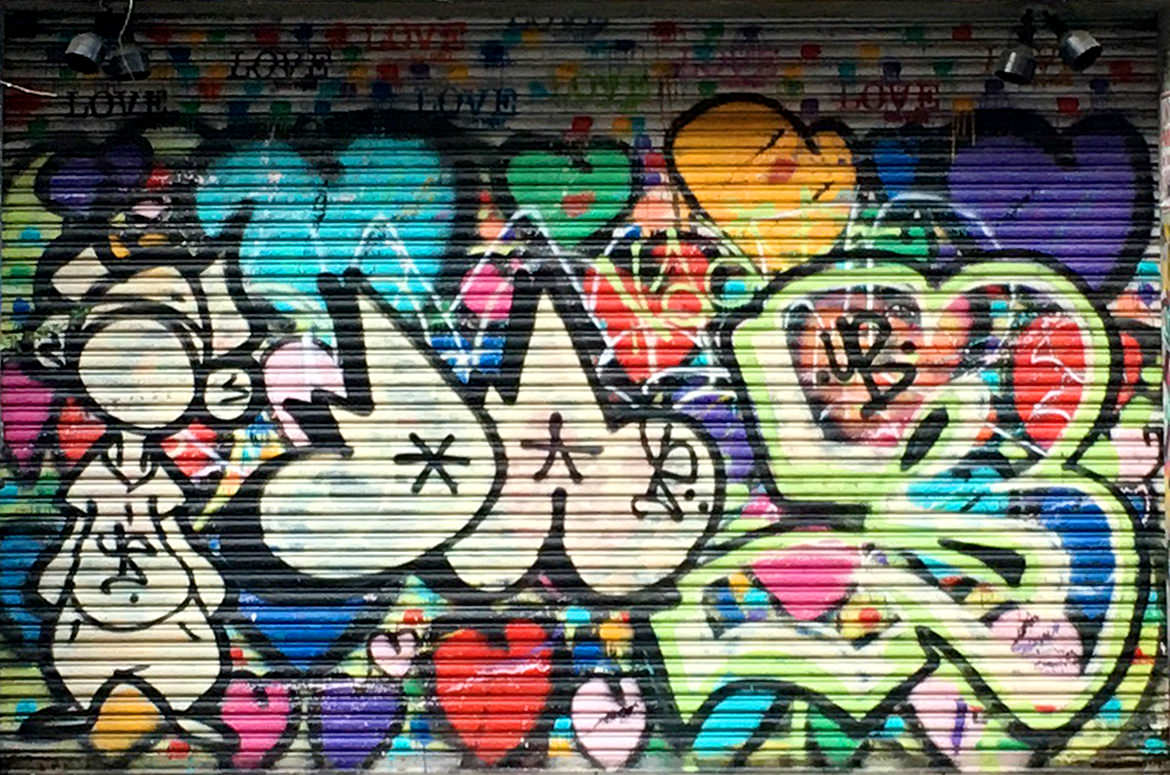 Spray paint graffiti collage of hearts and stylized lettering