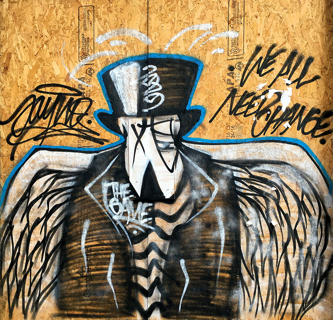 A spray paint cartoon bird wearing a black suit jacket, top hat and striped shirt with large white wings.